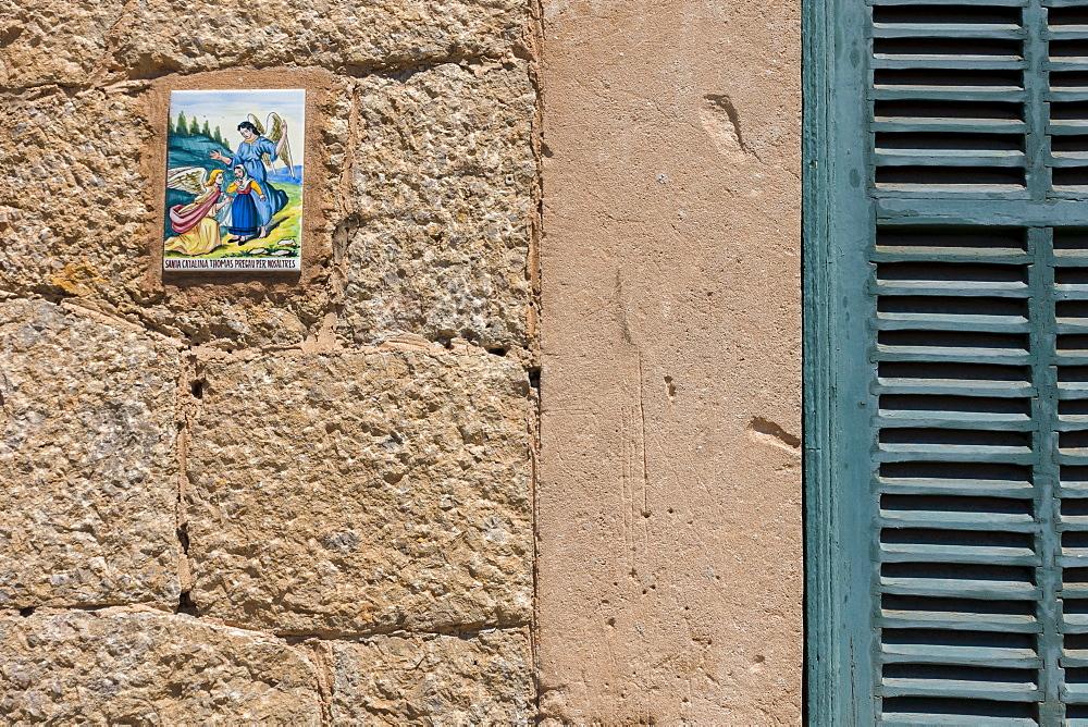 Close up of tile with angels on wall, Valldemossa, Mallorca, Spain