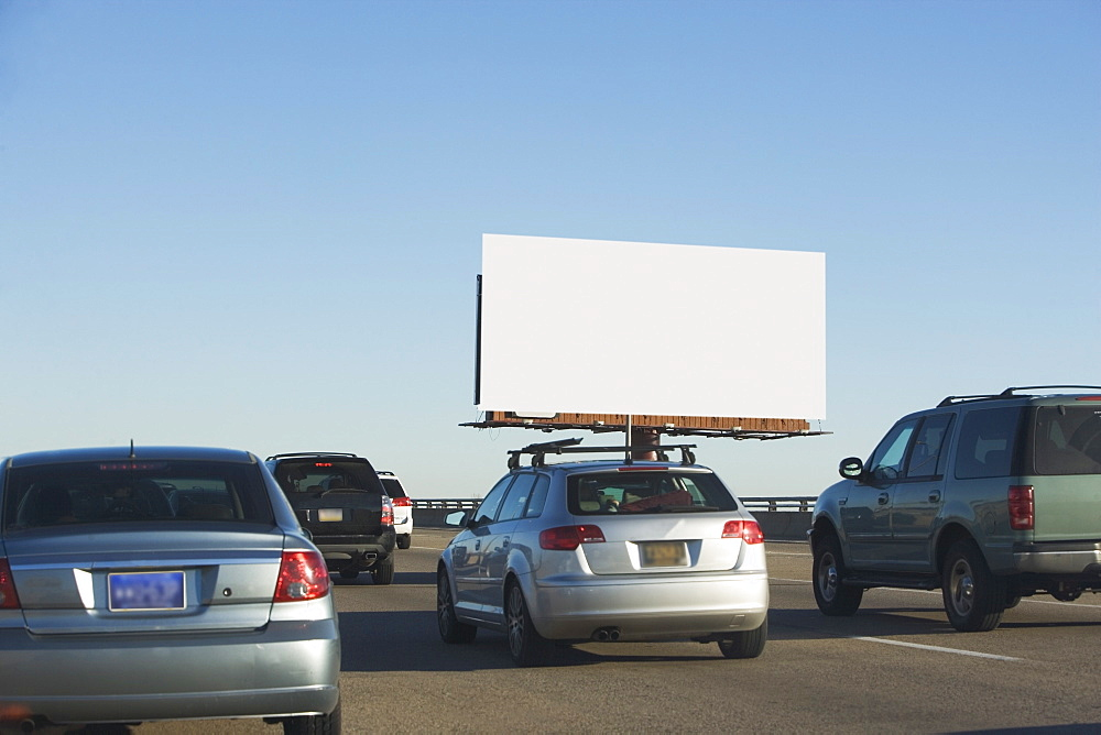 Traffic and blank billboard