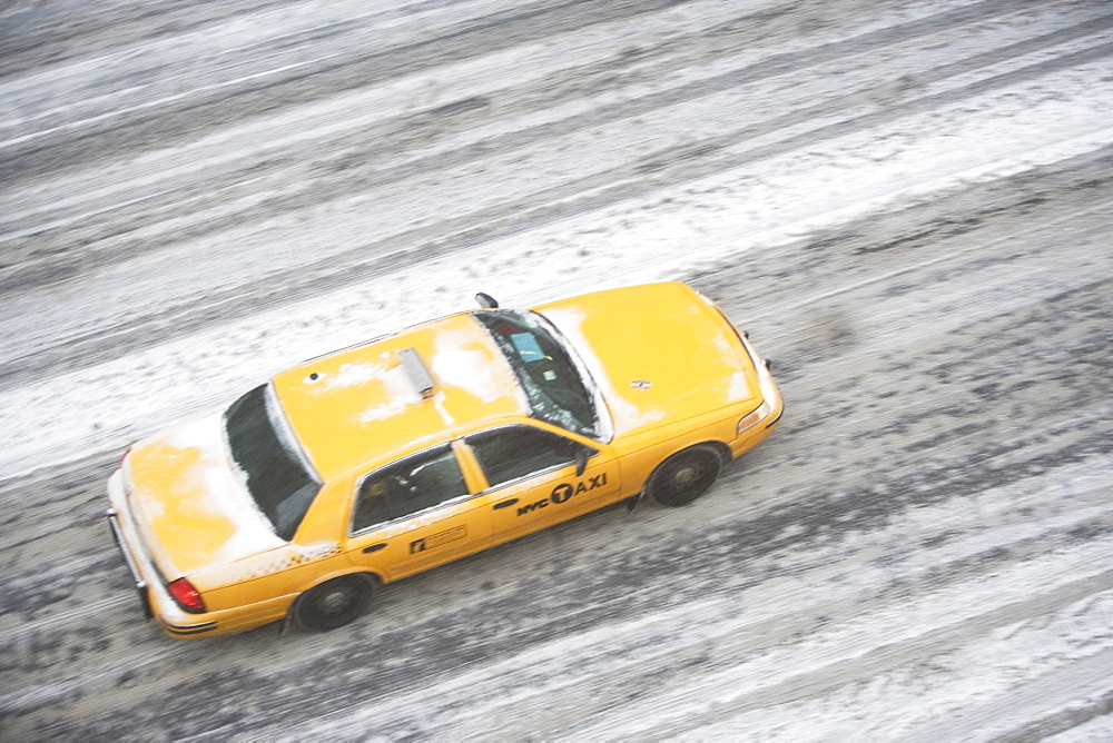 USA, New York State, New York City, blurred motion of yellow taxi