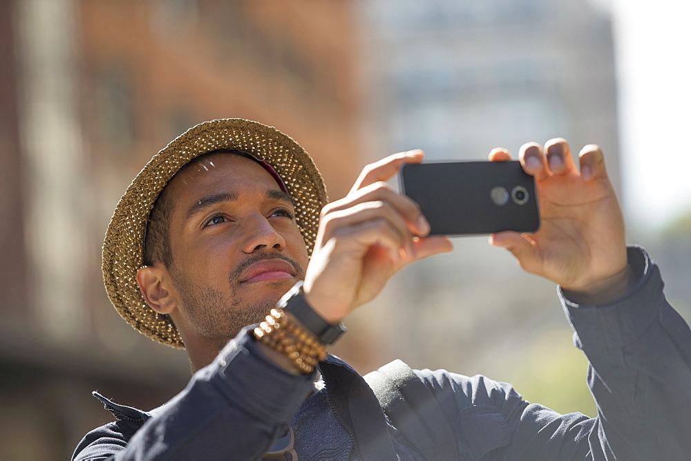 Man taking photo on street
