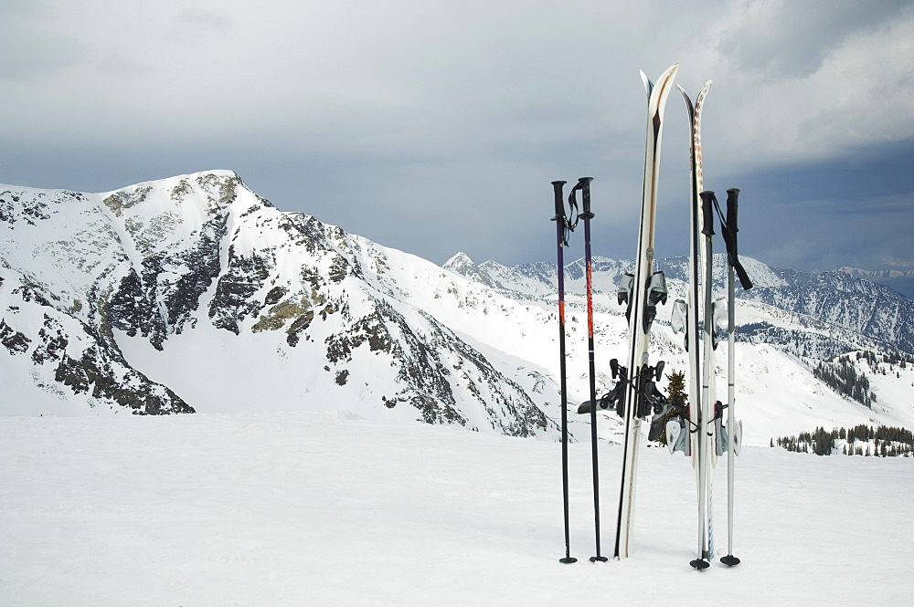 Skis and poles stuck in snow