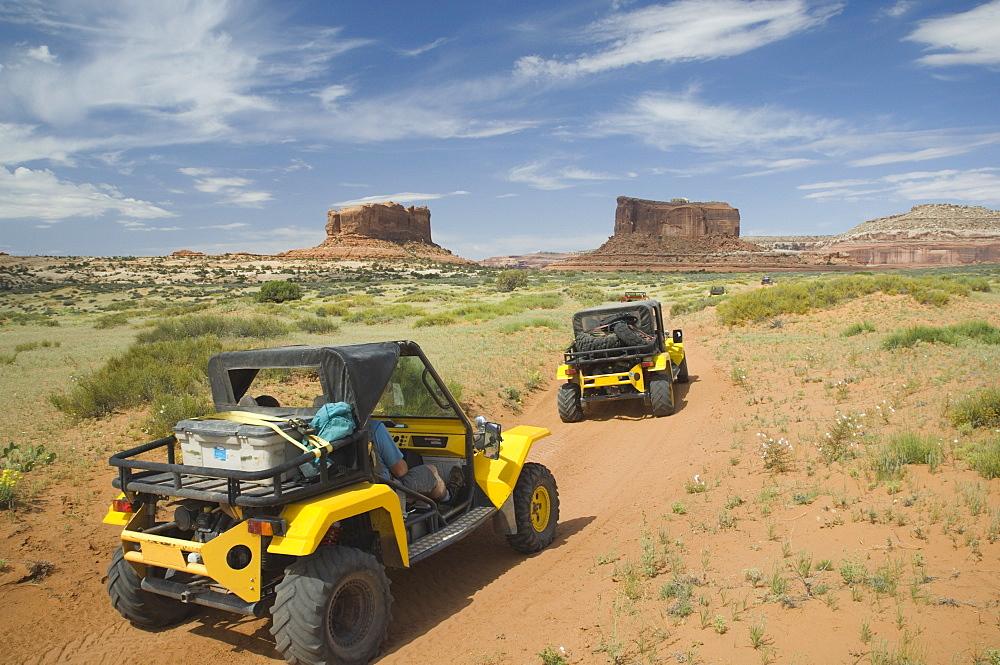 Off-road vehicles driving through desert