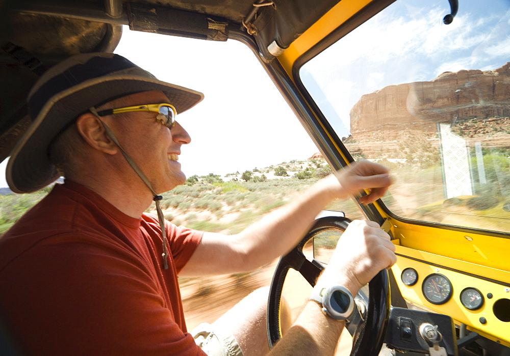 Man driving in desert
