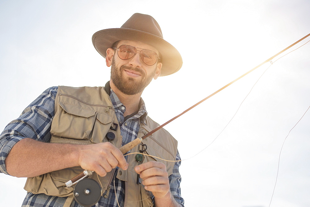 Portrait of man holding fishing rod
