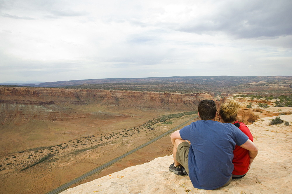 Couple looking over edge of cliff