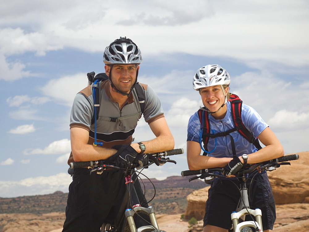 Couple sitting on mountain bikes
