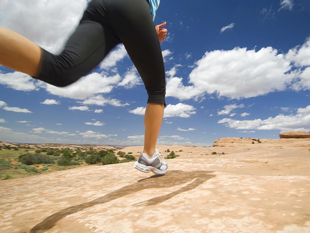 Woman jogging in desert