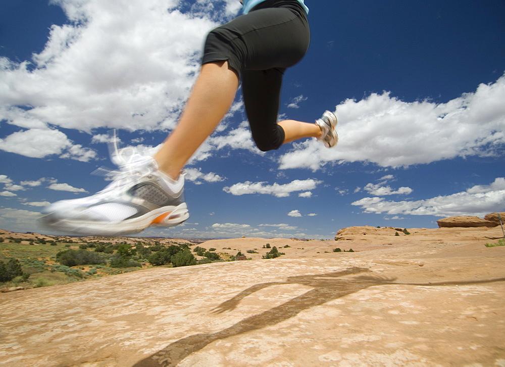 Woman jumping in desert