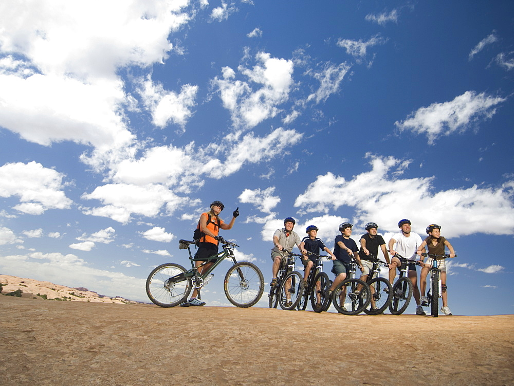 Group of cyclists in desert