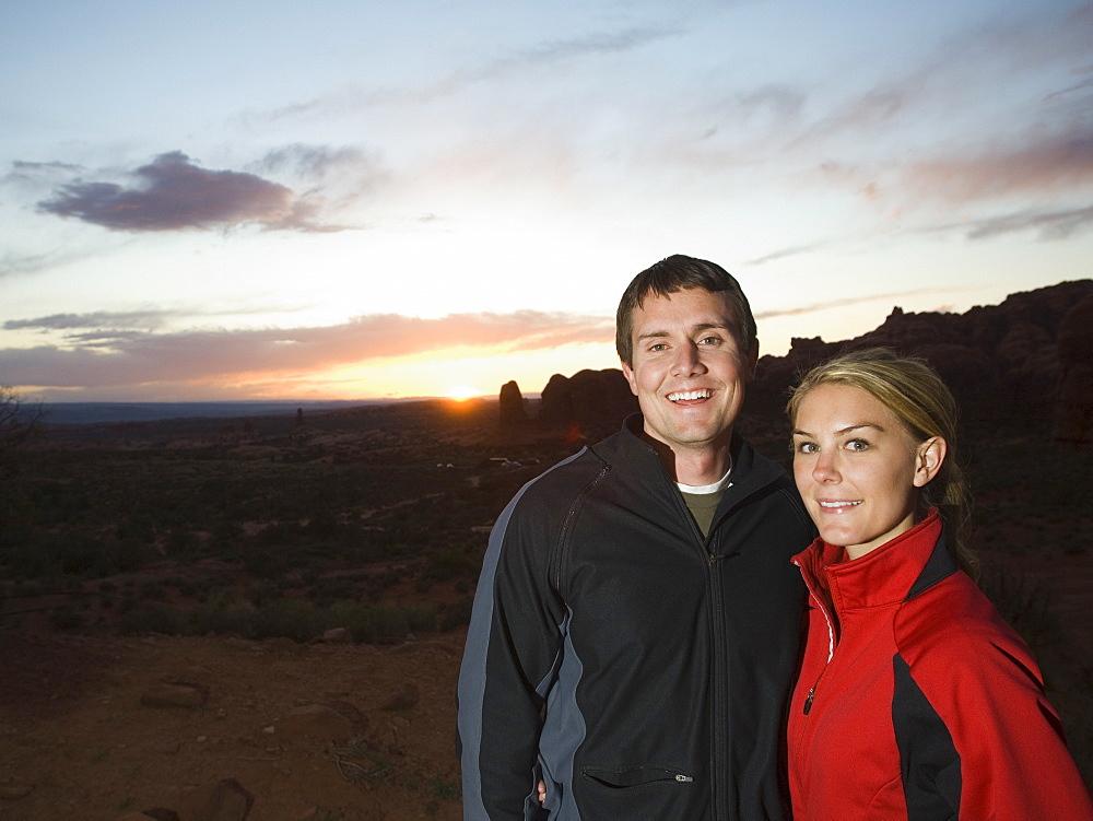 Couple in desert at dusk