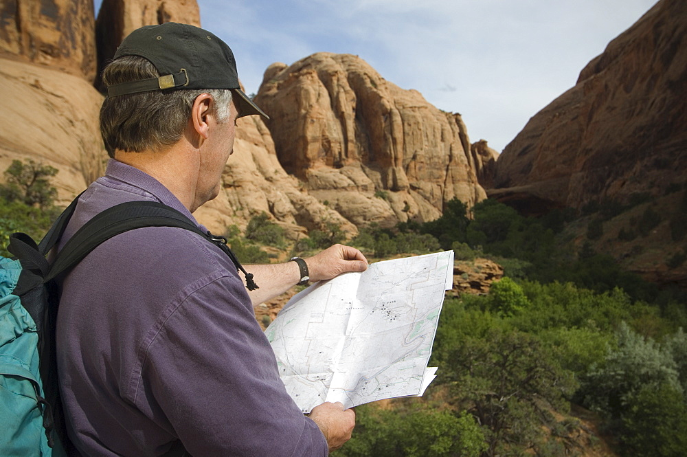Man looking at map