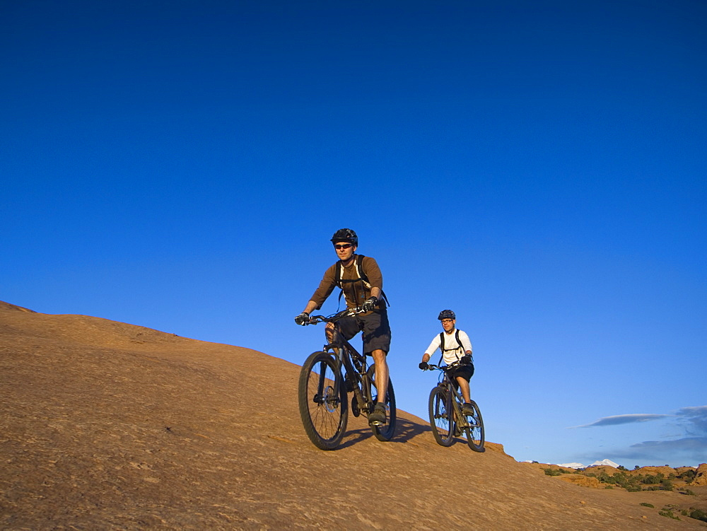 People riding mountain bikes