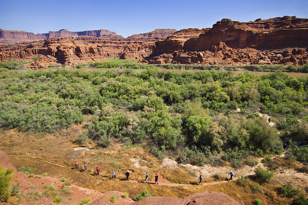 People hiking in canyon, Canyonlands National Park, Moab, Utah, United States