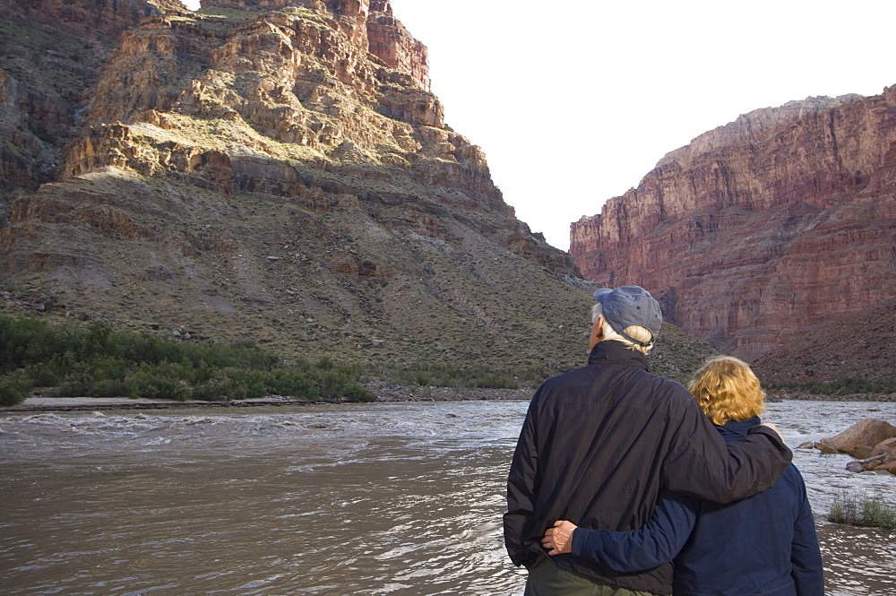 Couple looking at river, Colorado River, Moab, Utah, United States
