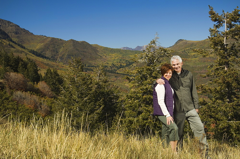 Senior couple hugging outdoors, Utah, United States