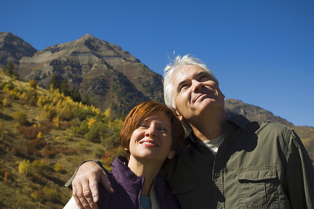 Senior couple hugging outdoors, Utah, United States