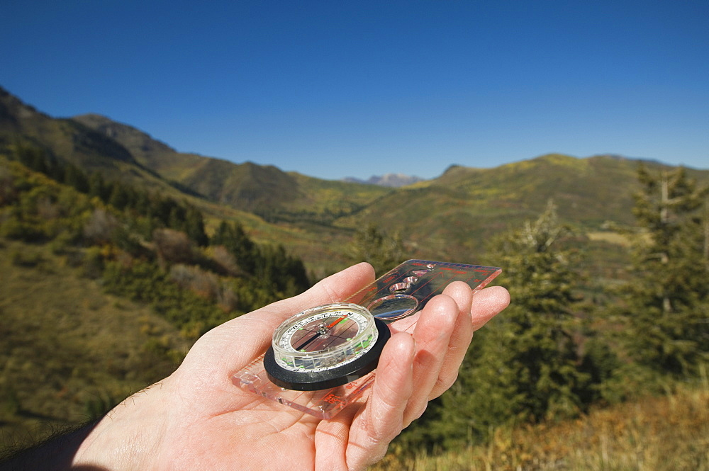 Close up of man holding compass, Utah, United States
