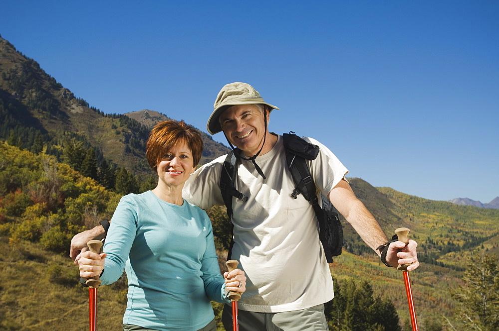 Senior couple holding hiking poles, Utah, United States