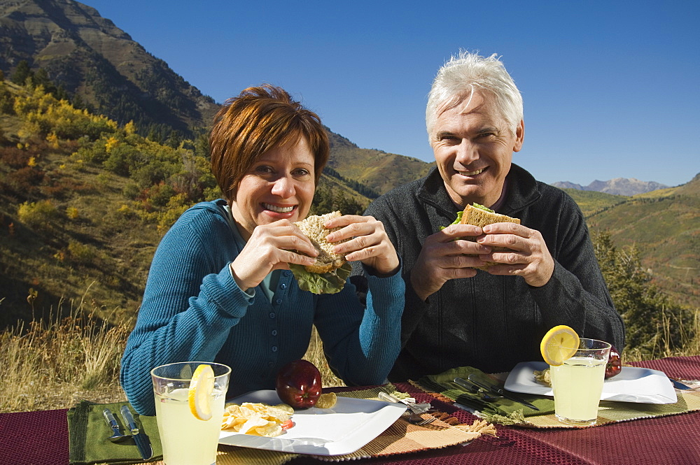Senior couple eating outdoors, Utah, United States