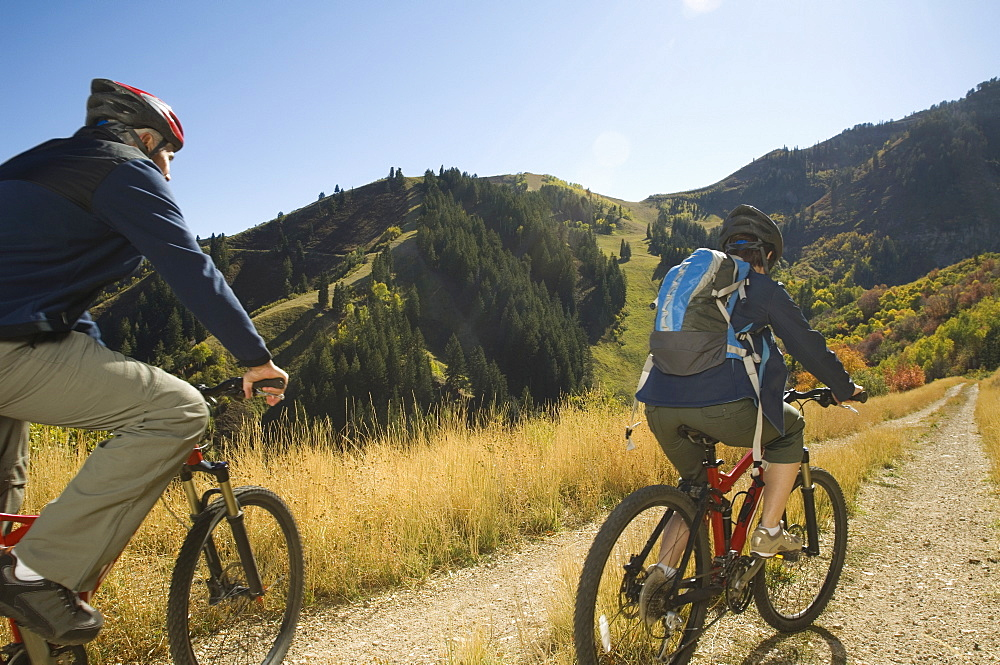 Senior couple riding mountain bikes, Utah, United States
