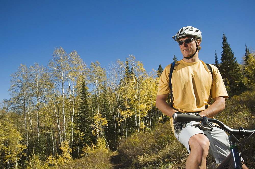 Man sitting on mountain bike, Utah, United States