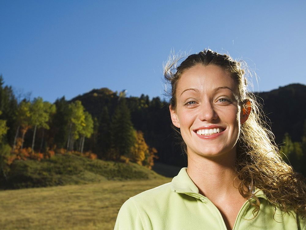 Woman with hair blowing outdoors, Utah, United States