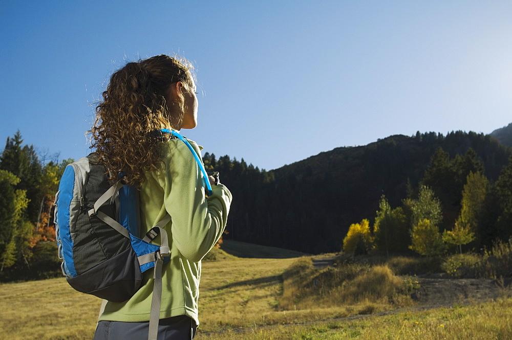 Woman wearing backpack outdoors, Utah, United States