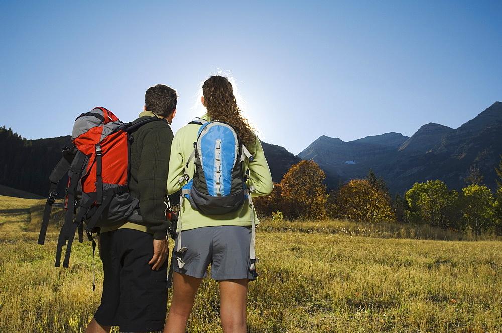 Couple wearing backpacks outdoors, Utah, United States