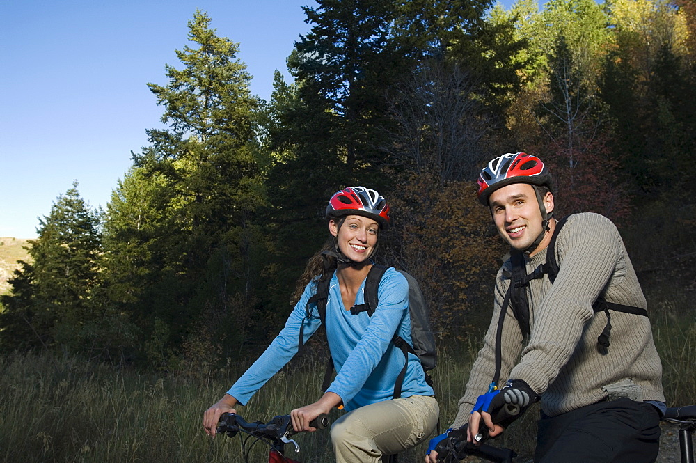 Couple on mountain bikes, Utah, United States