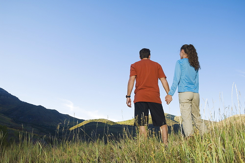 Rear view of couple holding hands, Utah, United States