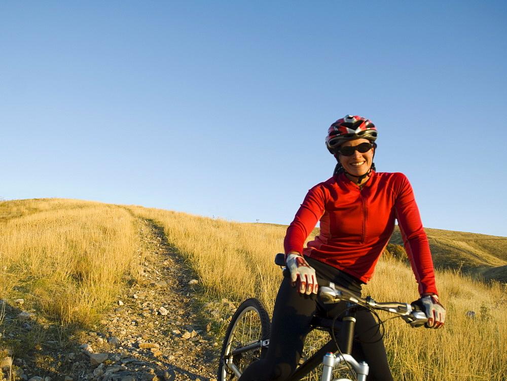 Woman on mountain bike, Salt Flats, Utah, United States