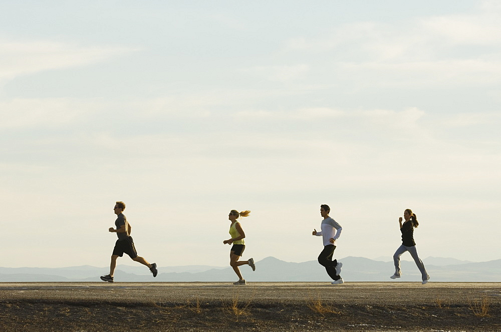 Group of people running on road, Utah, United States