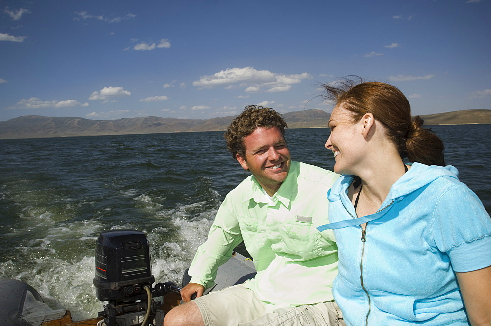 Couple on motorboat, Utah, United States
