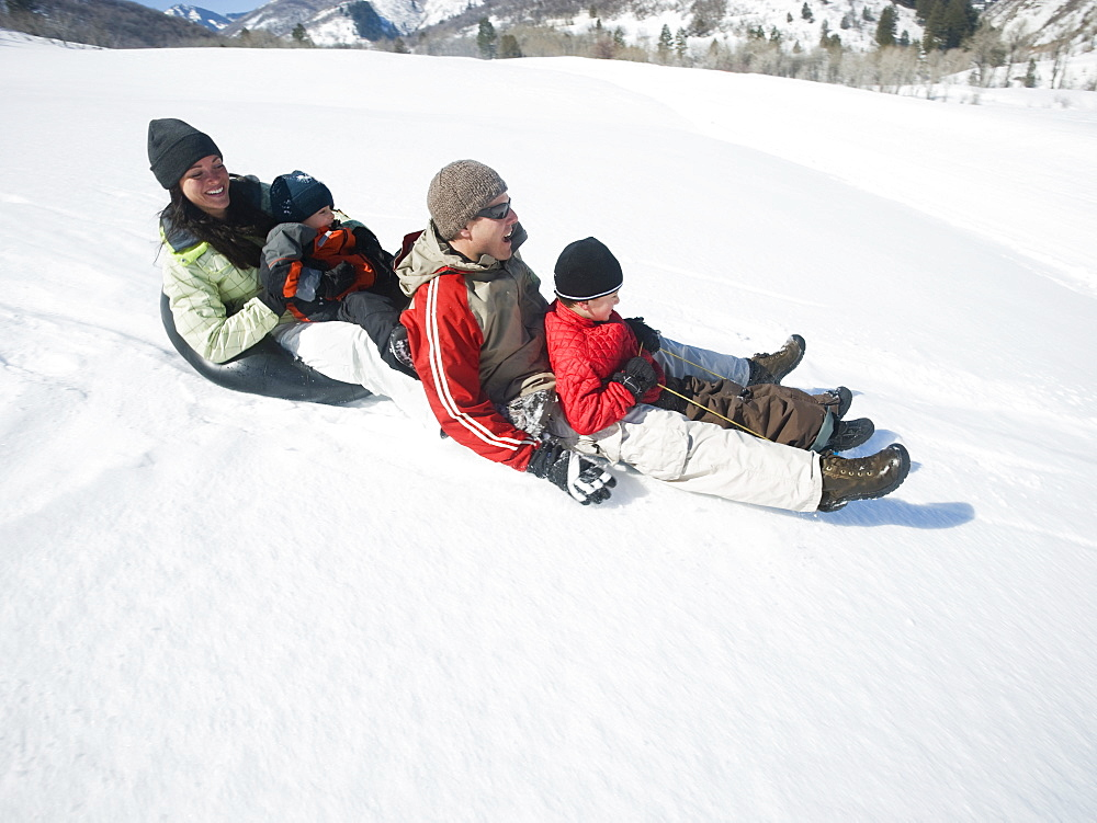 Family riding on sled