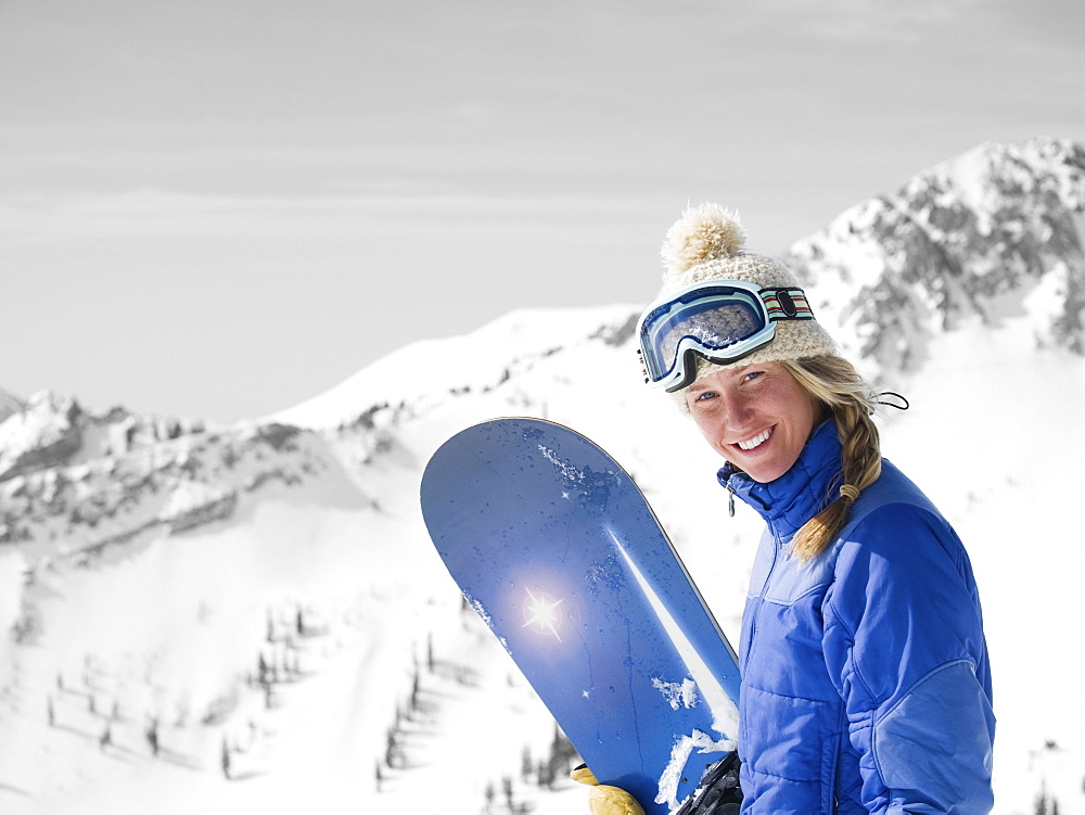 Woman holding snowboard