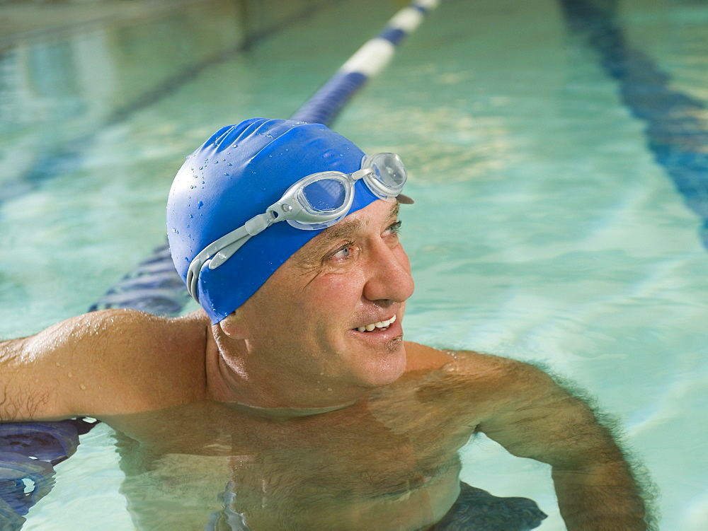 Man smiling in swimming pool