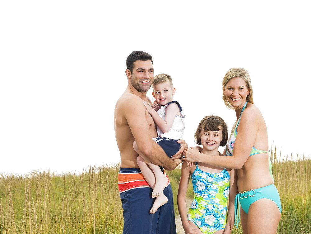 Portrait of family in bathing suits