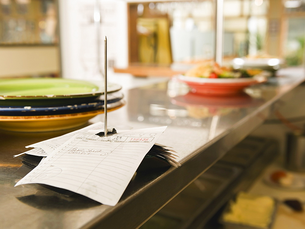 Food order spike in restaurant kitchen