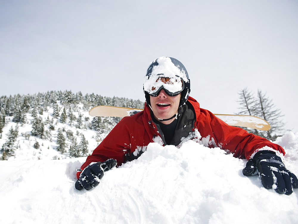 A snowboarder falling