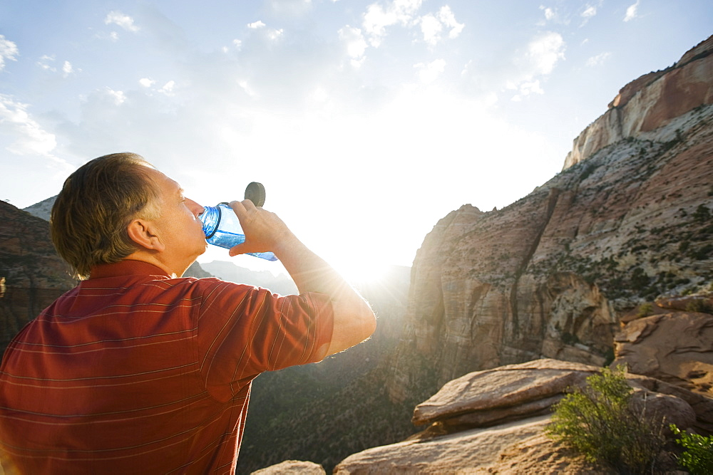 A man drinking water at Red Rock
