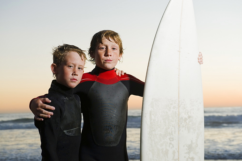 Children posed with surfboard