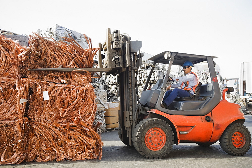Forklift driver working at recycling plant