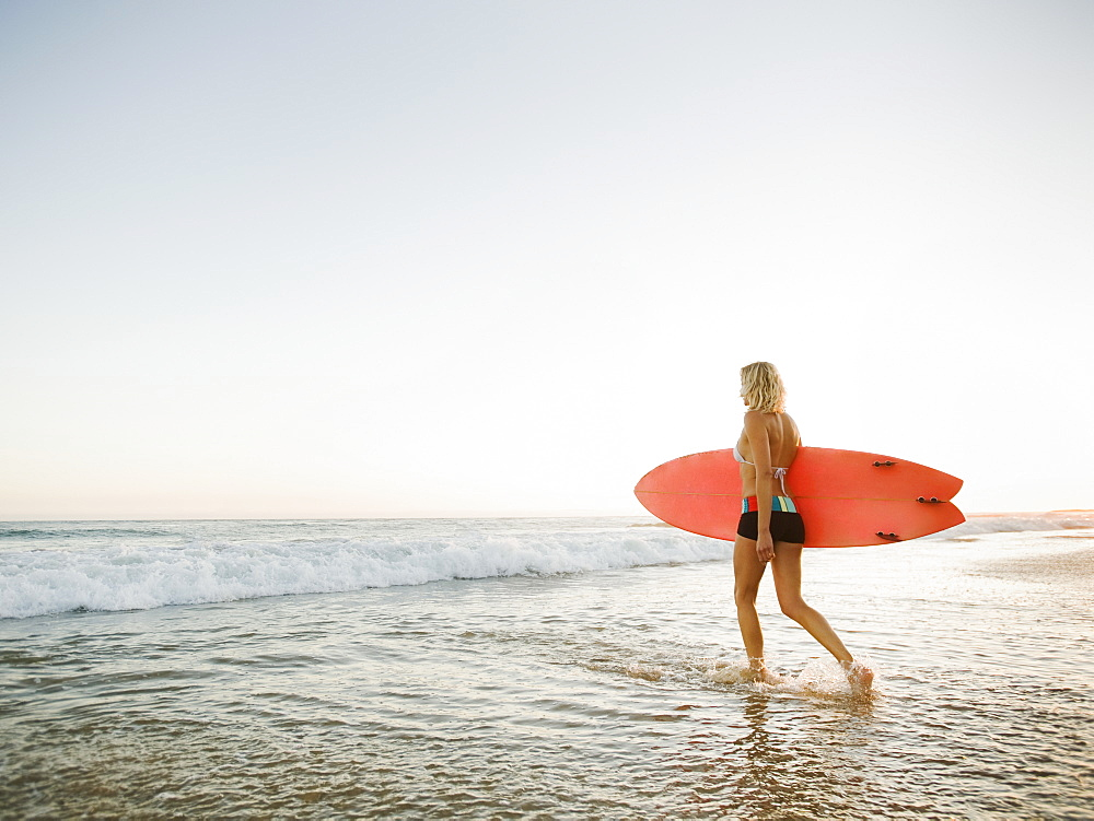 Portrait of woman with surfboard
