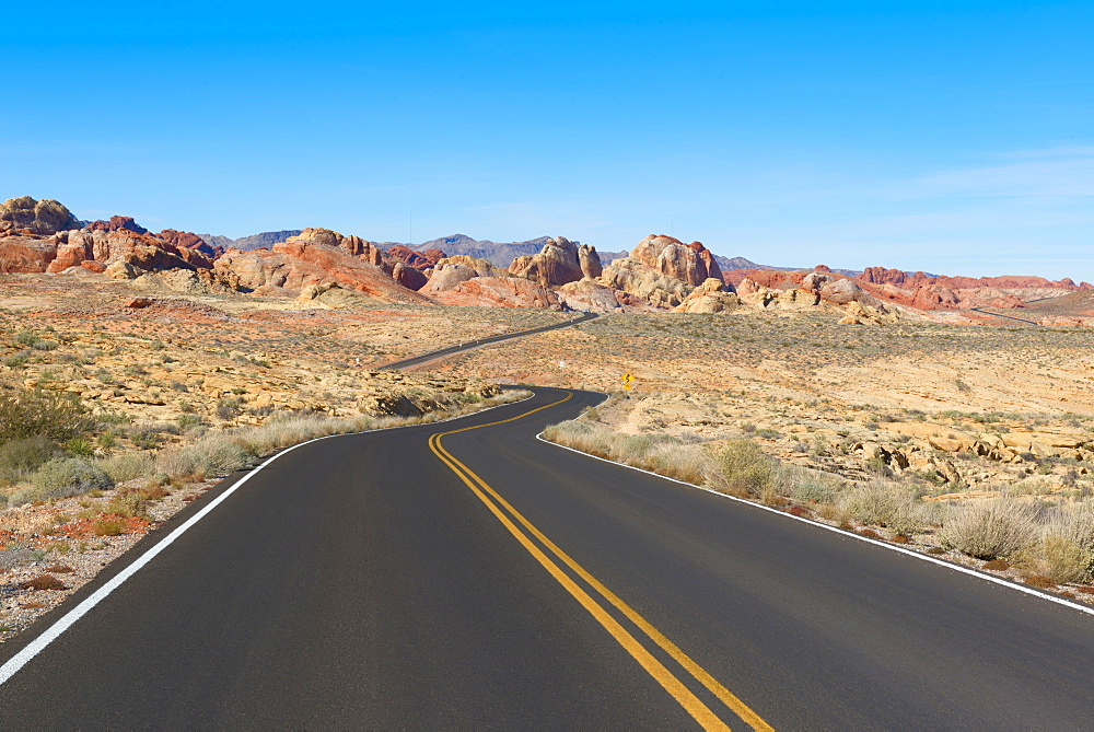 Empty road leading through desert, Valley of Fire State Park, California, USA