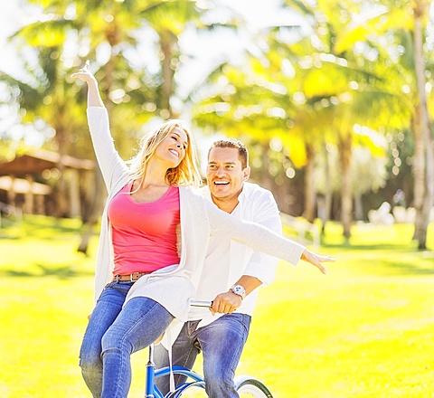 Couple riding on bike, Jupiter, Florida