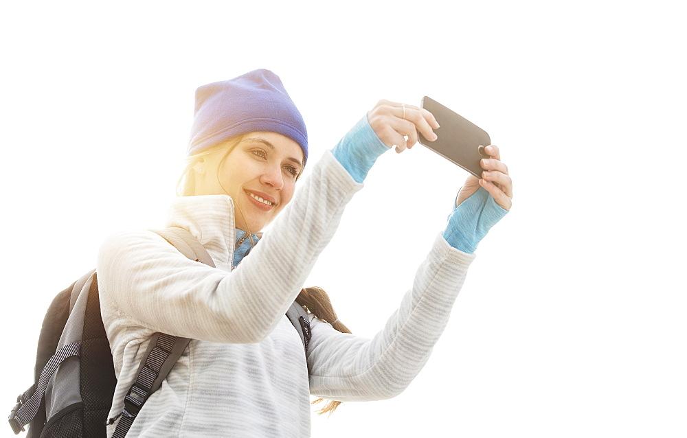 Female tourist taking selfie