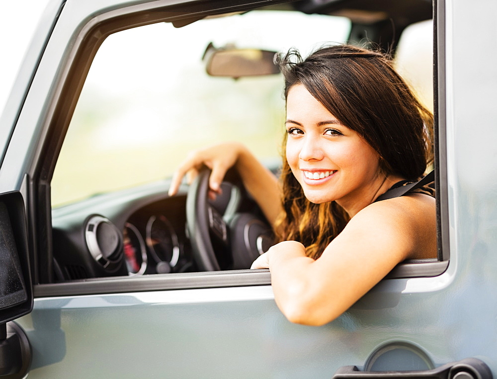 Portrait of young woman during road trip