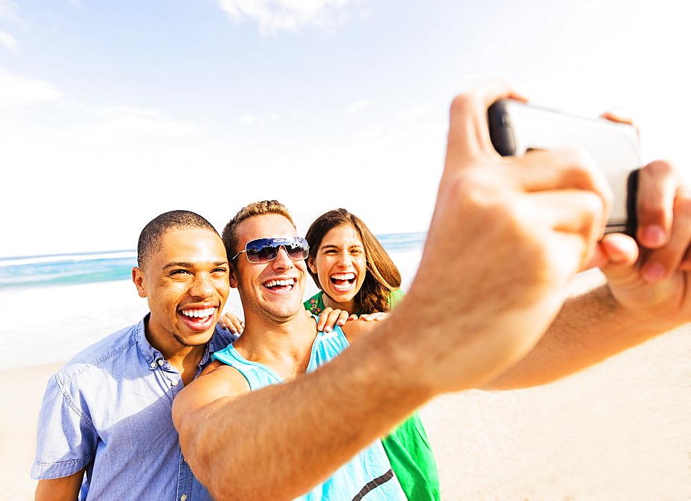 Young people taking selfie on beach, Jupiter, Florida