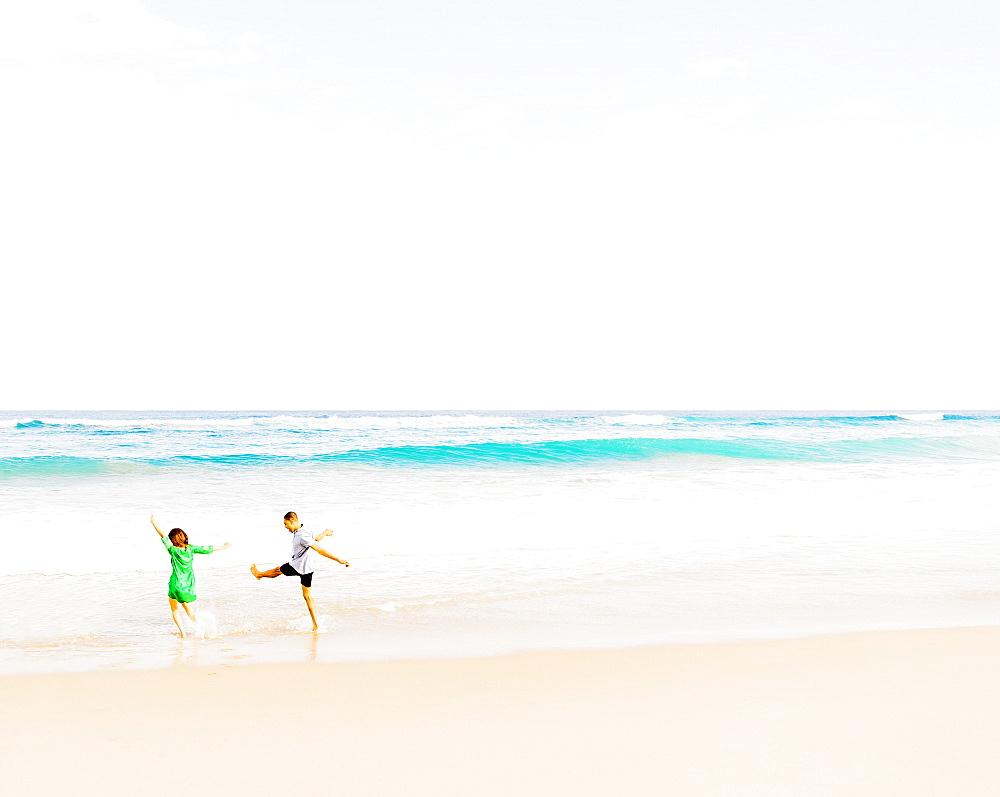 Young people walking and splashing in water, Jupiter, Florida