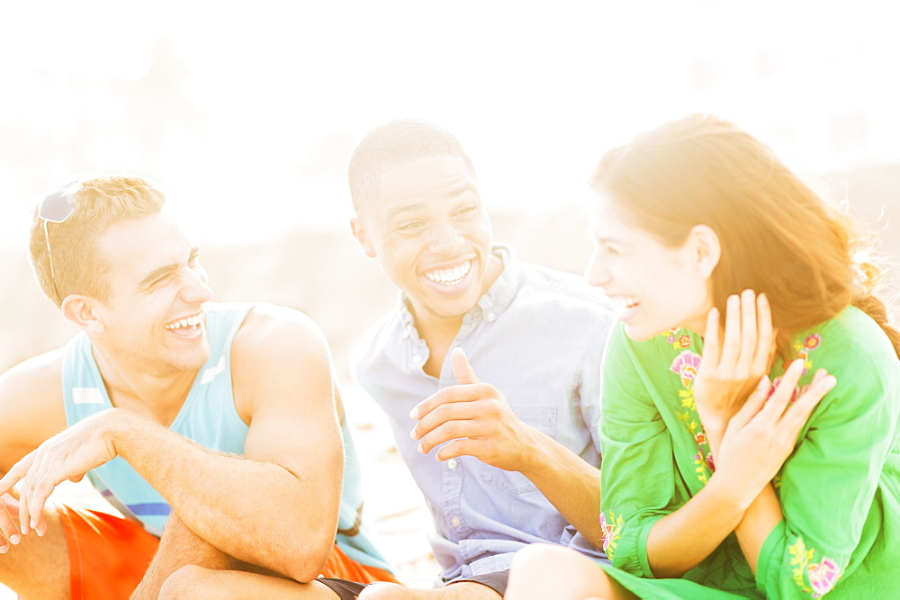 Young people talking and laughing outdoors